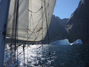 Our Sailrite built main, driving the hull through pins Christian Sound.  Southern Greenland 2015