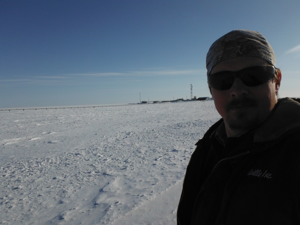Less than a mile behind me is our fuel depot, on the edge of a frozen seascape.