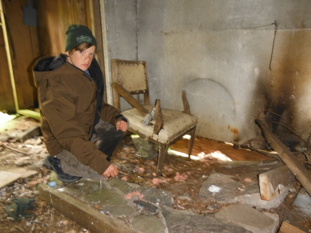 Steve sits at the fireplace of an old Island home that rots beneath our feet.  Steve and I agreed it was spooky.