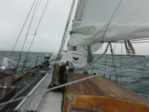 Approaching the shallows under a reefed main and power.
