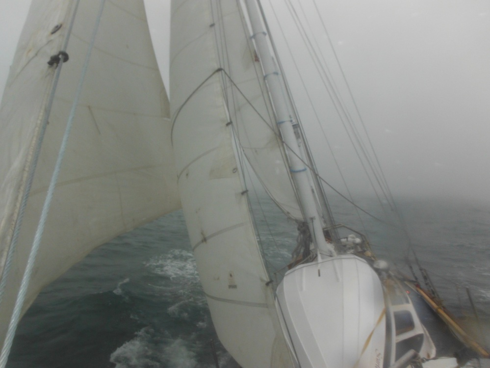 Single reef and all canvas at 6 knots.  Standing on hard for Nome.