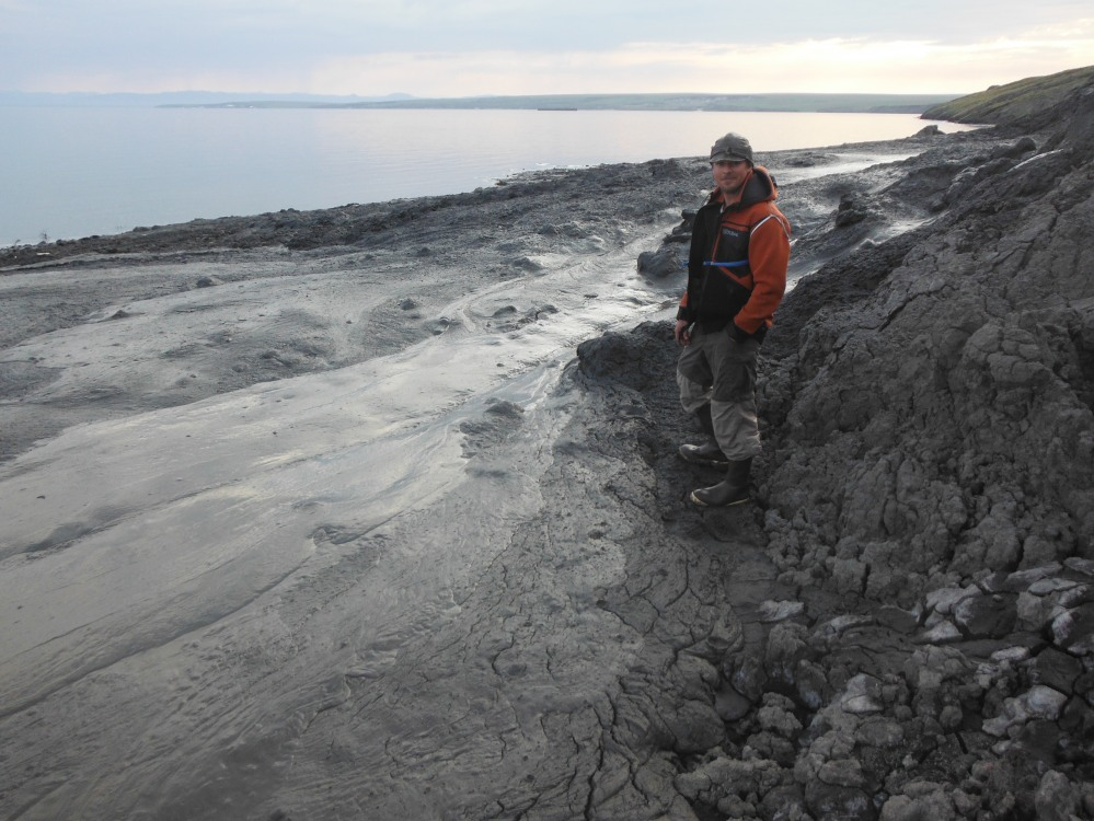 A river of melting permafrost, sends lava like mud into the sea near Hershel.