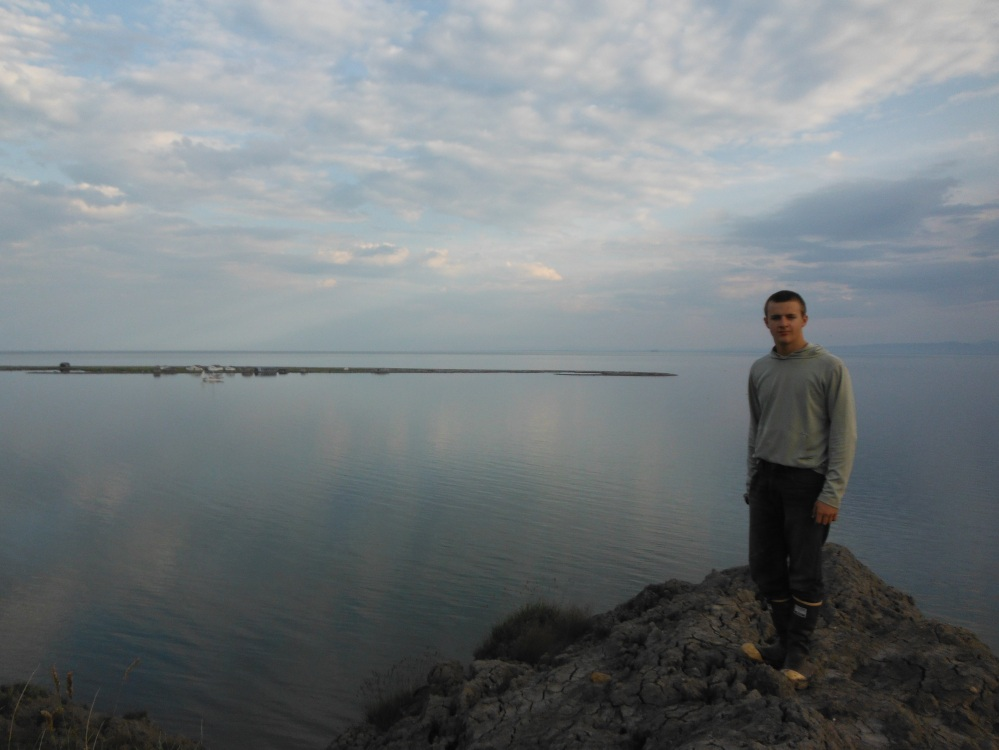 Isaac stands on a mound of rapidly melting permafrost, overlooking Herhsel.