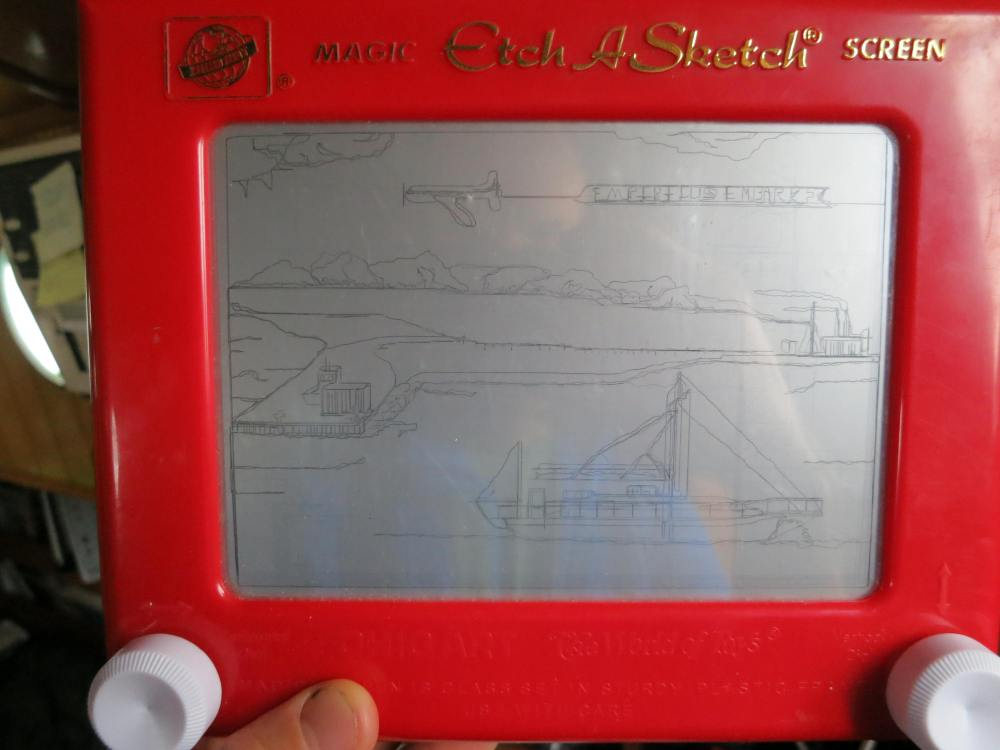 The gift of etch a scetch is silly, but entertaining none the less.  Pictured here is a scene of our anchorage on the slope.