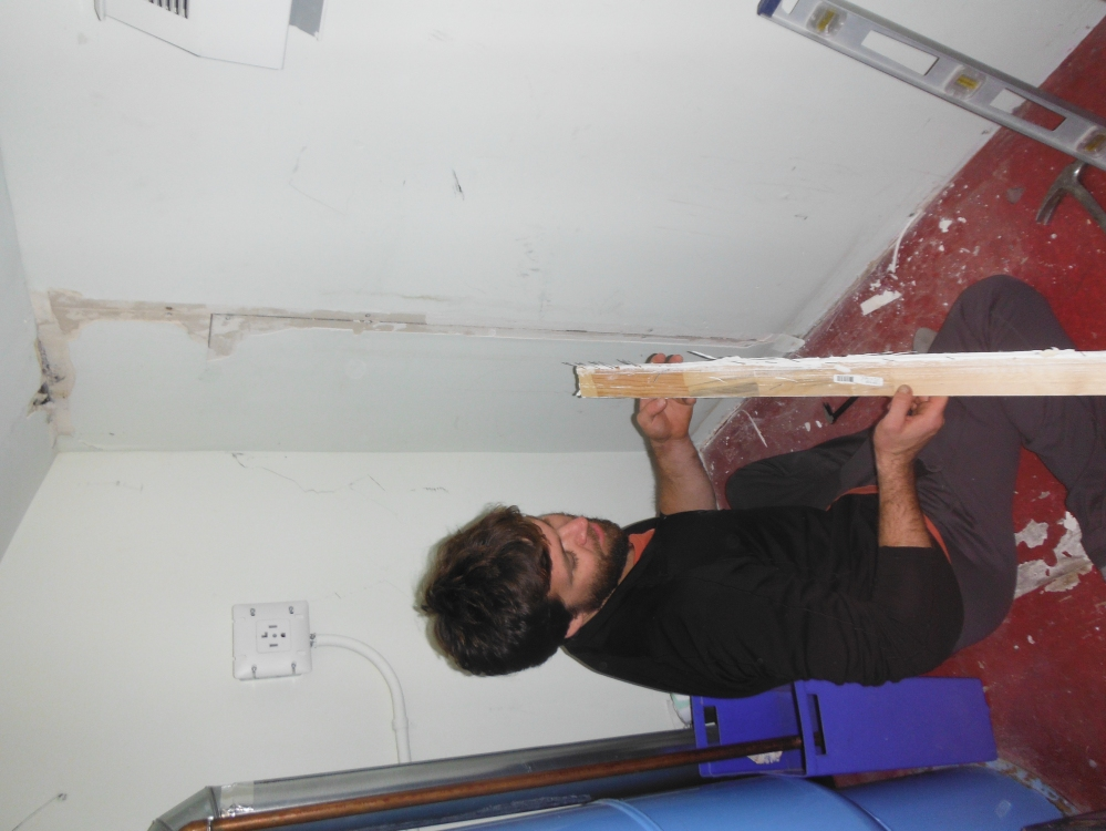 Jason doing some drywall for our friends.