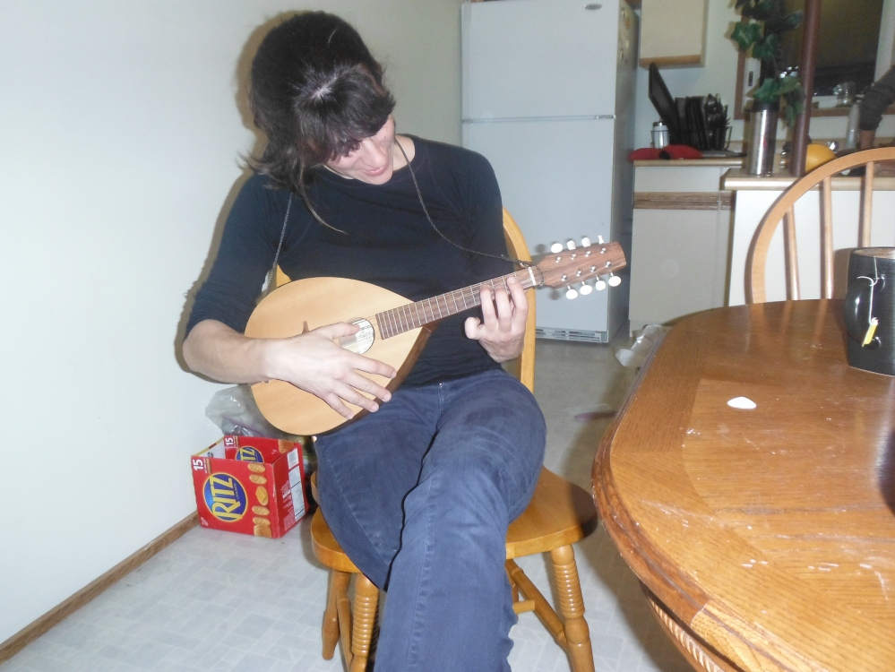 Samantha touches a Mandolin for the first time.  And begins to resonate.
