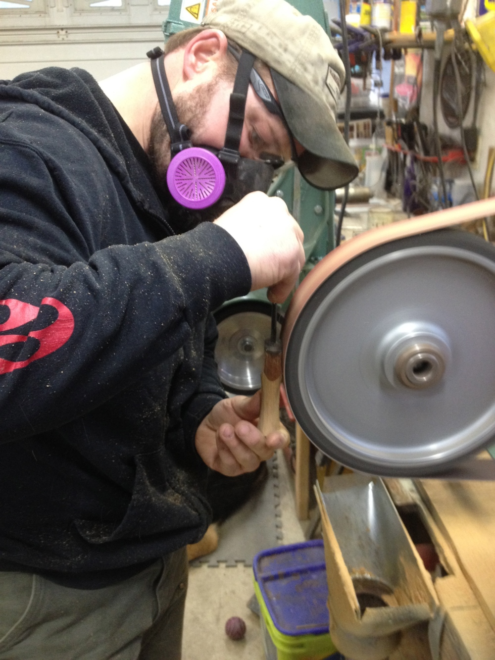 Odean grinding some teak.