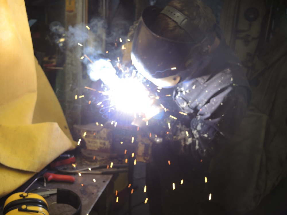 Welding the mass together.