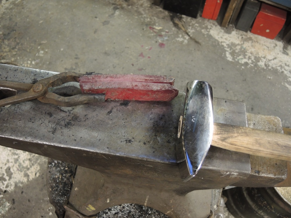 Hand folding on the anvil.