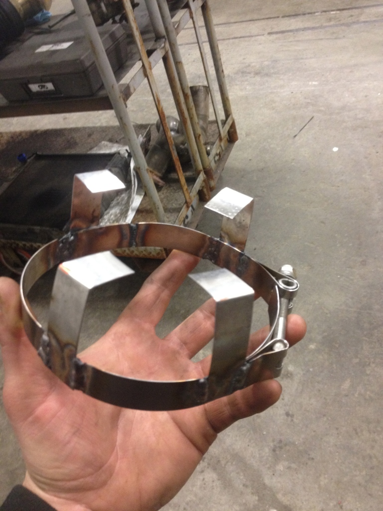 Modified, lengthened band clamp