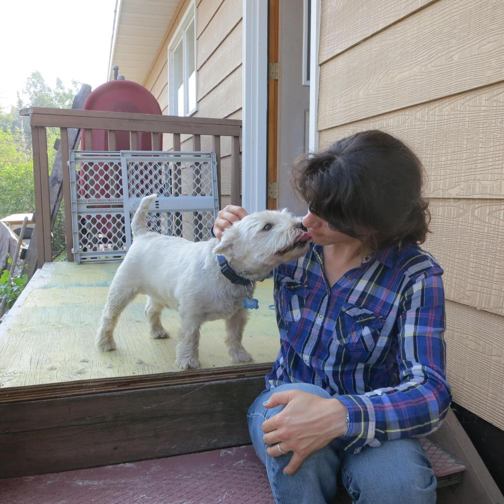 """Samantha kissing her buddy """"Tico"""" goodbye for a while."""