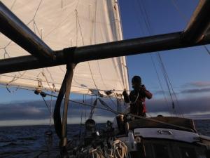 Samantha tending reef lines at the main boom