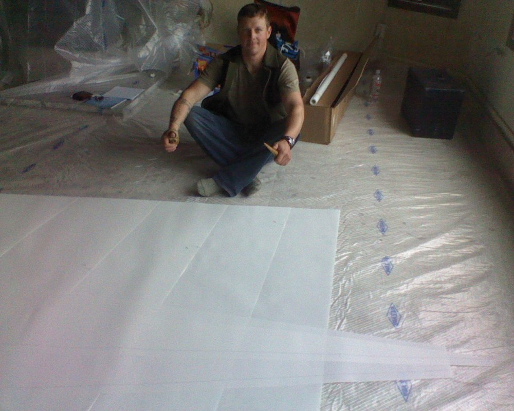 Sewing the mainsail that would carry us to Greenland
