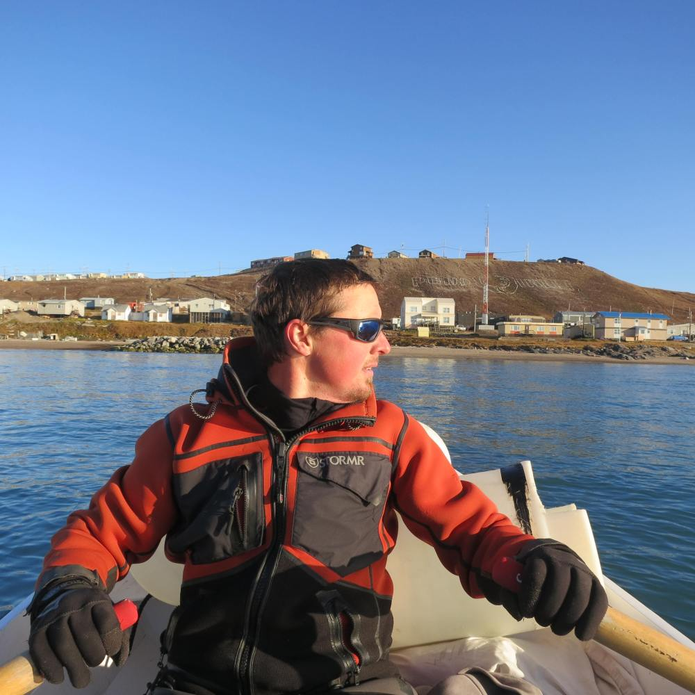 Rowing the tender into Pond Inlet, having transited the Northwest Passage