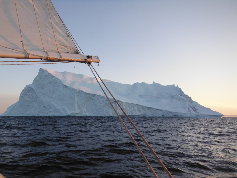 Sailing amongst floating ice mountains in Disko Bay Greenland